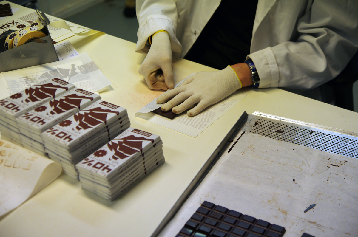 Hand wrapping the chocolate bars at Chocolatemakers in Amsterdam